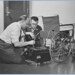 George Klein works on his battery powered wheelchair at the NRC.